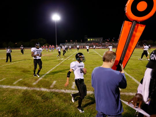 Gainesville State School players run back to the sideline