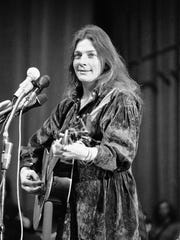 Singer-songwriter Judy Collins performs at a rally