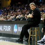 West Virginia coach Bob Huggins believes Kentucky will be a near impossible team to beat in the NCAA Tournament.