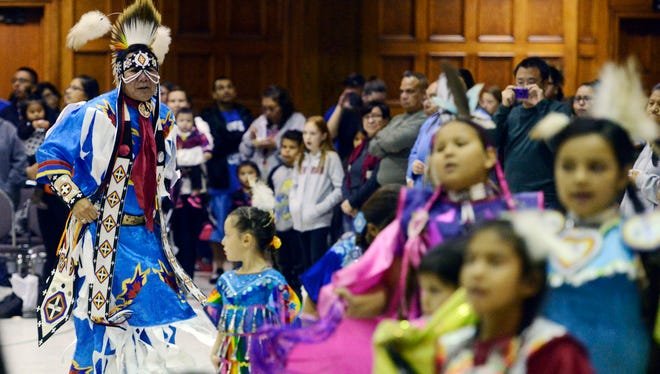 Harvey Bordeaux of Eagle Butte dances during the grand entry at a Native American Day Wacipi Monday at the Multi-Cultural Center in Sioux Falls, Oct 13, 2014.