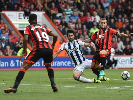 AFC Bournemouth's Jack Wilshire, right, and West Bromwich Albion's Claudio Yacob battle for the ball during their English Premier League soccer match at the Vitality Stadium, Bournemouth, England, Saturday, Sept. 10, 2016. (Daniel Hambury/PA via AP)