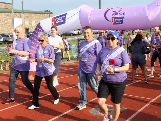 Cancer survivors, caregivers, volunteers and community members take part in the American Cancer Society Relay For Life at Brewster High School June 10, 2017. The Relay For Life movement is the world's largest fundraising event to save lives from cancer.