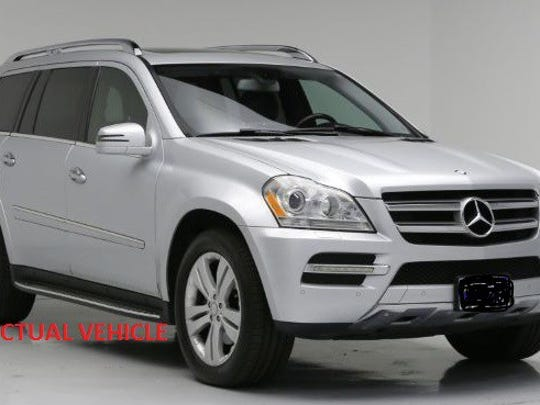 The suspects were seen in a silver 2012 Mercedes Benz GL4, like the one shown, with Delaware registration 244719, police said.