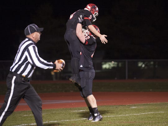 Lenape's Matt Lajoie is hoisted by teammate Kyle Fuchs after Lajoie scored a touchdown in the first quarter of Friday's South Jersey Group 4 semifinal game.