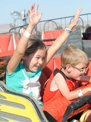 Nora Graham, 8, of Yerington and her brother Ben, 5, take a spin on a ride at the Lyon County Fair.