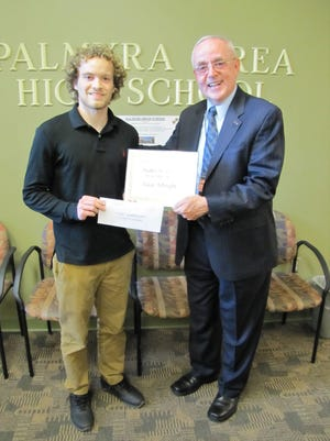 Frank Ryan, GOP candidate in the 101st Legislative District, presents Isaac Albright, a Palmyra Area High School senior, with a certificate declaring him the second place winner of the 2016 Walter L. Smith Memorial Scholarship.