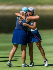 Emma Kieffer and Katelyn Le hug after completing the