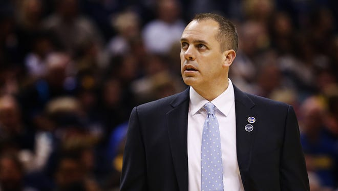 Indiana Pacers head coach Frank Vogel looks up at the scoreboard as a timeout is called at Bankers Life Fieldhouse on Dec. 31, 2015.