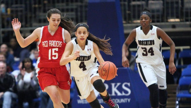 Ossining freshmen Jaida Strippoli (4) and Kailah Harris (34) during the Class AA final at the Westchester County Center Feb. 28, 2016.