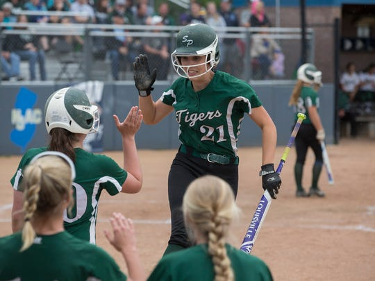 South Plainfield's Jillian Holoboski celebrates with team mates after scoring her team's first run of game. South Plainfield Softball wins nail biter over Steinert in Group III Championship at Kean University in Union NJ on June 4, 2017.