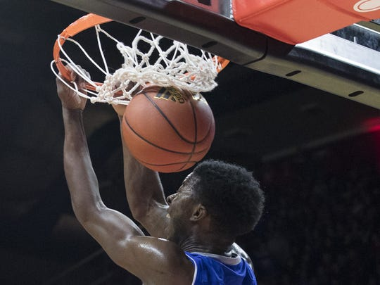 Seton Hall's Myles Cale slams home a dunk on a long pass down court as first half comes to an end. Rutgers vs Seton Hall Basketball in Piscataway on December 16, 2017