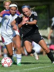 East's Sydney O'Donnell (right) works for the ball
