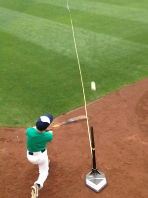 Kurt Felix swings for the fence during the hitting category at the pitch, hit and run competition.