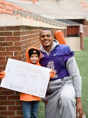 Savana Jones, 8, smiles for a photo with then-quarterback