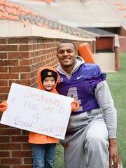 Savana Jones, 8, smiles for a photo with then-quarterback Deshaun Watson after giving him a good-luck hug