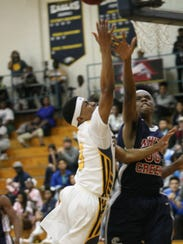 Northeast's Jontae Brown drives to the basket and attempts