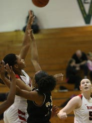 Rossview's Semajia Ogburn takes a shot over the defense