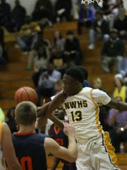 Northwest's Shatar McClay fights for a rebound against