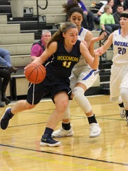 Woodmore's Katie Brugger drives the baseline against