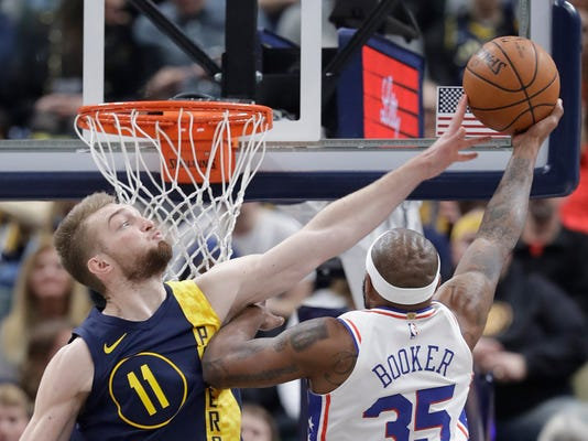Indiana Pacers' Domantas Sabonis (11) blocks the shot of Philadelphia 76ers' Trevor Booker during the second half of an NBA basketball game, Saturday, Feb. 3, 2018, in Indianapolis.(AP Photo/Darron Cummings)