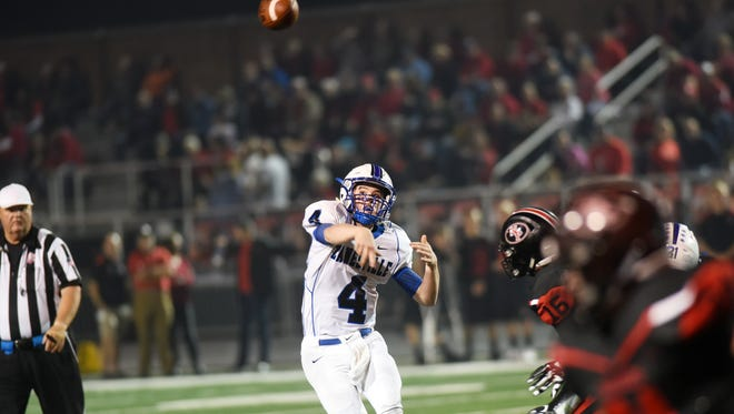Zanesville's Ben Everson fires a pass during the third quarter of the Blue Devils' 37-14 loss on Friday to New Philadelphia. Everson passed for 197 yards.