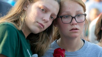 Students embrace during a vigil for victims of the Santa Fe school shooting in Santa Fe, Texas following a shooting that killed 10 at Santa Fe High School  at Santa Fe High School, May 18, 2018.
