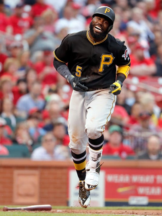 Pittsburgh Pirates' Josh Harrison grimaces after being hit by a pitch during the fourth inning of a baseball game against the St. Louis Cardinals, Monday, April 17, 2017, in St. Louis. (AP Photo/Jeff Roberson)