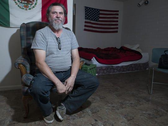 Ramon Gonzalez poses in his apartment on Aug. 2, 2017