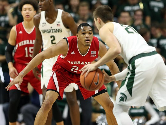 Nebraska's James Palmer Jr., defending Michigan State's Matt McQuaid in the Spartans' 86-57 home win last season, is averaging 19 points per game for the Cornhuskers.