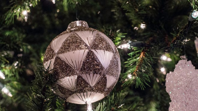 An ornament hangs from a Christmas tree inside the sanctuary at St. Paul's Lutheran Church, 121 S. 18th St., on Monday, Dec. 11, 2017.
