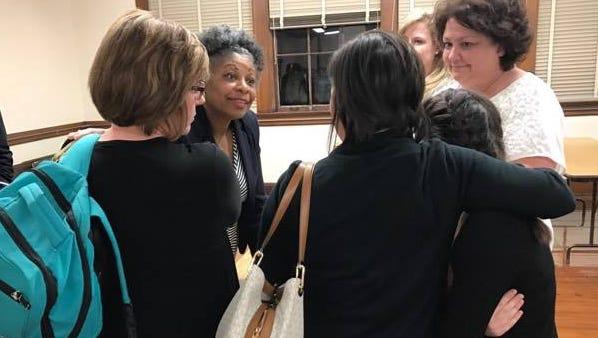 Bolton's school board representative Sandra Franklin talks to concerned parents.