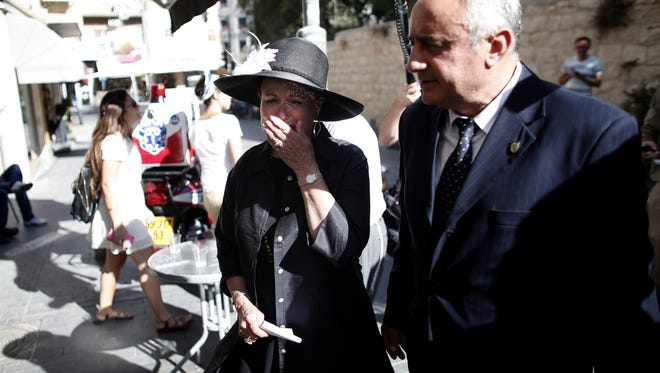 Esther Pollard, left, the wife of Israeli spy Jonathan Pollard, gestures after speaking during a news conference on a street in downtown Jerusalem on July 29, 2015.