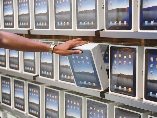 Shelves of Apple iPad products on display in the new