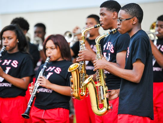 Members of the Northside High School band perform at