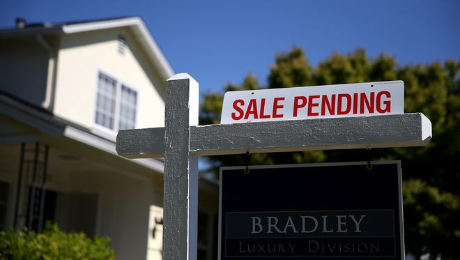 A sale pending sign is posted in front of a home for sale in San Anselmo, Calif.