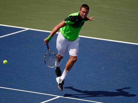 Jack Sock, of the United States, returns a shot against Pablo Andujar, of Spain, during the first round of the 2014 U.S. Open tennis tournament, Tuesday, Aug. 26, 2014, in New York. (AP Photo/Elise Amendola)