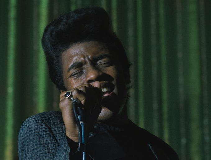 "Chadwick Boseman portrays music great James Brown in 'Get on Up.' Director Tate Taylor says the movie, due out on Aug. 1, shows the key moments in Brown's life but it is not a linear, cradle-to-grave biopic. ""It's all who he is, but we're going to put it on shuffle instead of play."""