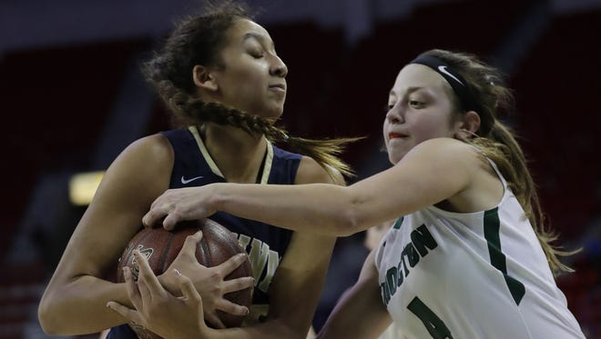 Shiocton High School's Jackie Korth, right, fights for control of the ball against La Crosse Aquinas' Kyah Steiner during their WIAA Division 4 State Tournament semifinal girls basketball game Thursday at the Resch Center in Ashwaubenon.