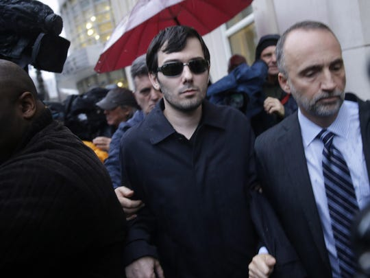 Martin Shkreli, center, leaves the courthouse after