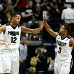 Vince Edwards and P.J. Thompson exchange a high five during a Penn State time out Wednesday, January 13, 2016, at Mackey Arena. Purdue defeated Penn State 74-57.