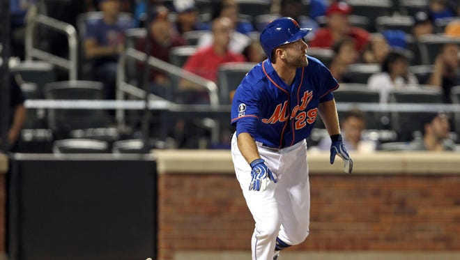 Mets left fielder Eric Campbell watches the flight of his three-run homer against the Chicago Cubs in the fourth inning Friday night at Citi Field.