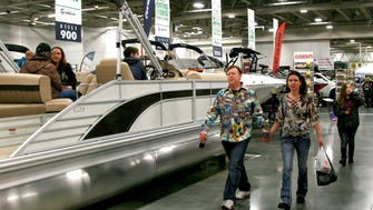 Outdoor sports enthusiasts peruse the boating section Saturday of the Milwaukee Journal Sentinel Sports Show at State Fair Park. Just as thousands of people are shopping for boats and campers, prices could soon rise from the aluminum and steel tariffs.