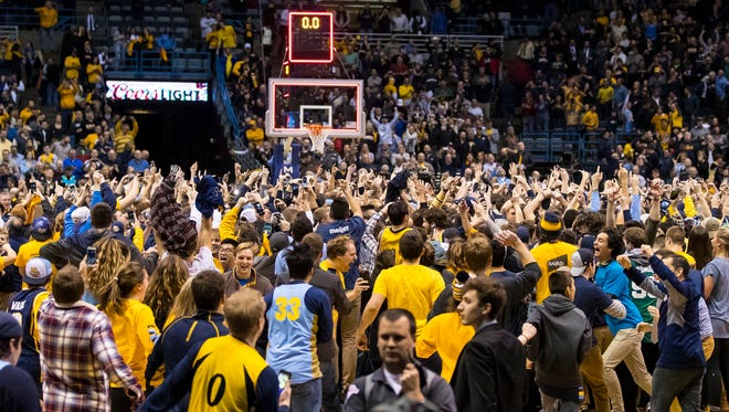Marquette fans storm the BMO Harris Bradley Center court on Jan 24, 2017 after the Golden Eagles toppled No. 1 Villanova, 72-70.