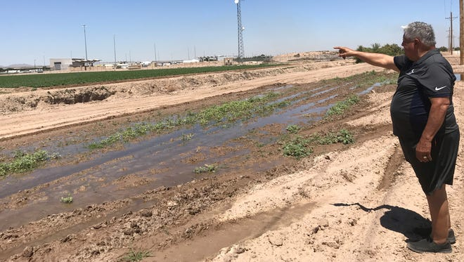 """Inocente """"Chente"""" Quintanilla points to the tent city near the Tornillo port of entry. The facility, which has been used to house about 400 immigrant children, has drawn thousands of protesters and dozens of public officials to the small Texas town."""