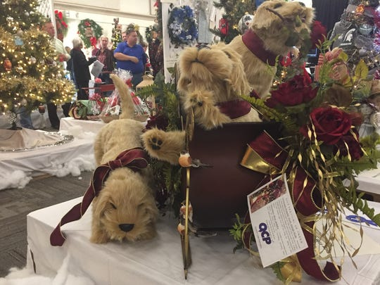 This holiday display honoring man's best friend was donated to the annual Festival of Trees event by Quality Care Partners.