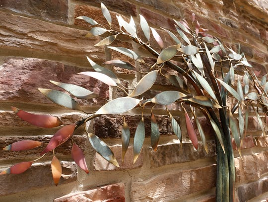 Ohio artist Tom Yano used copper, bronze and brass to compose a metal tree sculpture for Westminster Village.