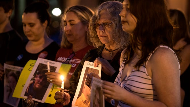 People gather at Garden St. and Palafox St. Sunday, in Pensacola, Florida  February 18, 2018, for the Candlelight Vigil for Parkland Shooting Victims. The vigil was hosted by Mom's Demand Action, Indivisible Northwest Florida and Progressives Northwest Florida.