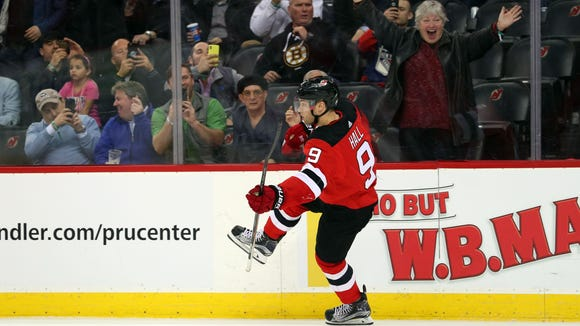Apr 3, 2018; Newark, NJ, USA; New Jersey Devils left wing Taylor Hall (9) celebrates his goal during the second period of their game against the New York Rangers at Prudential Center