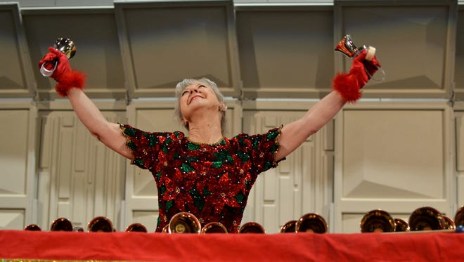 Christine Anderson, 66, performed a Christmas in July concert Thursday. The handbell musician came to Rochester for the Handbell Musicians of America's yearly naitonal seminar.