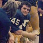 You can bid on Rudy's game-worn jersey, helmet